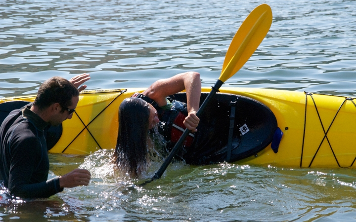 Kayak tipping exercise during outdoor education training in Washington