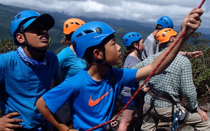 students learn rock climbing skills