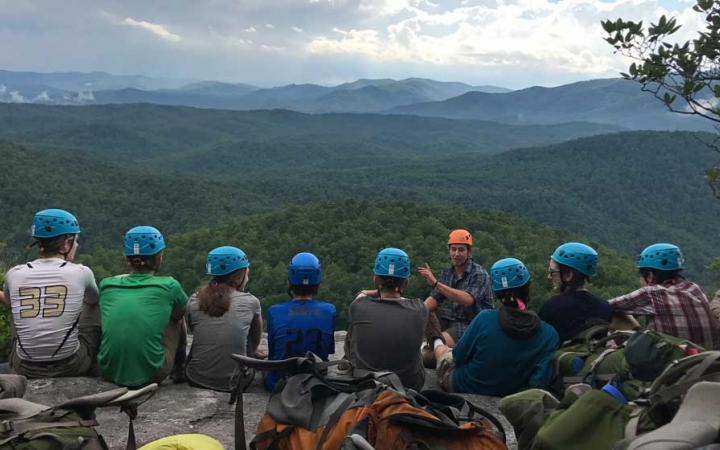 teens learn rock climbing skills in north carolina