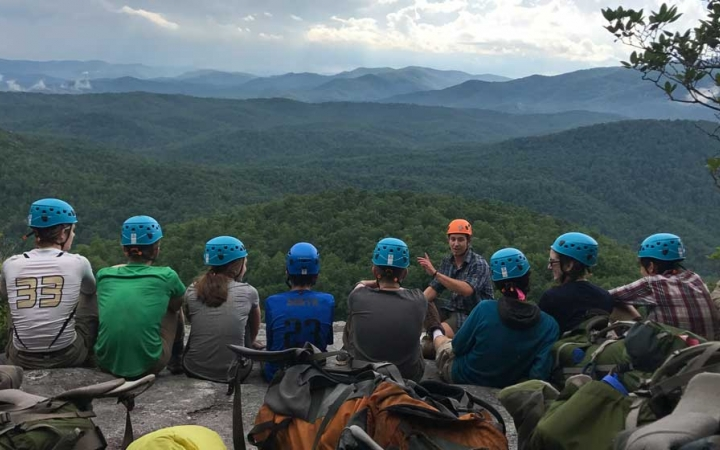 students learn rock climbing skills on outdoor education course