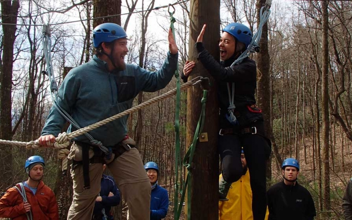 adults learn rock climbing skills in blue ridge mountains
