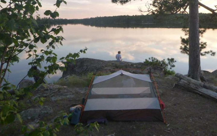 adult camping trip in boundary waters