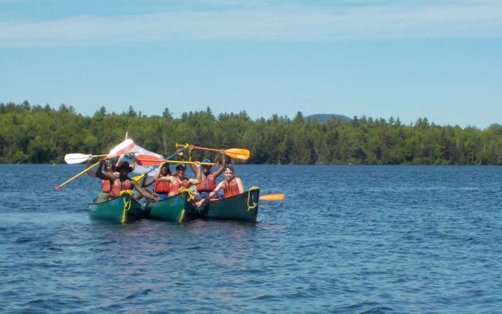 teens learn canoeing skills