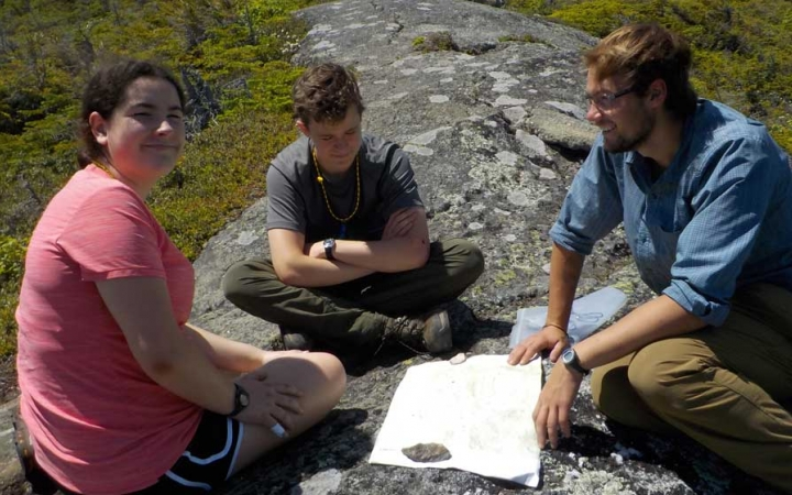 teens using map in maine