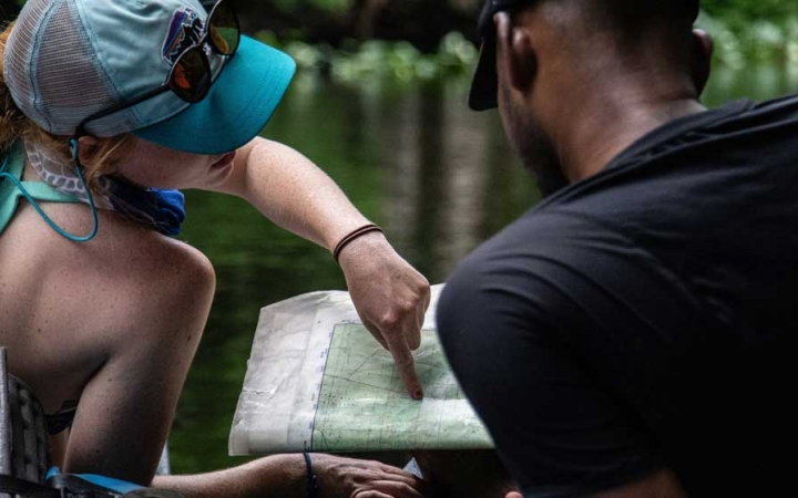 young adults learn map skills on outdoor leadership course